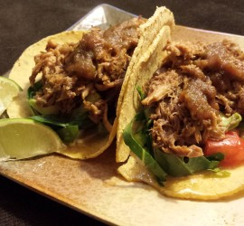 Tacos carnitas with fresh shredded collard greens