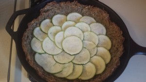 Zucchini quiche with potato crust, in progress.